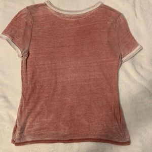 Red t-shirt with white collar and cuffs